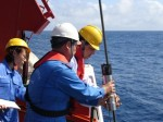 Marine geophysicist Jian Lin deploying instruments. Jian will answer your questions by email!